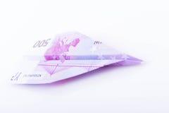 Avión de papel hecho con un euro 500 Fotos de archivo libres de regalías
