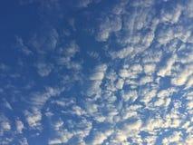 Avion à réaction en nuages Photographie stock