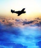 Avion au-dessus des nuages 3 Photographie stock