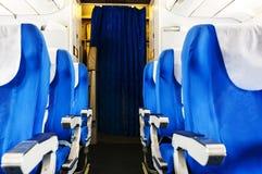 Avion avec des passagers sur des sièges Photo libre de droits