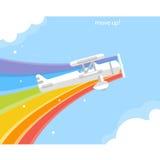 Avion avec un vol d'arc-en-ciel dans le ciel Photos stock