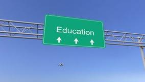 Avion commercial passant le panneau routier d'éducation Rendu 3d conceptuel Photo libre de droits