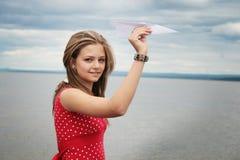 Avion d'adolescent et de papier Photos stock