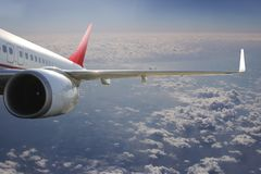 Avion dans l'avion de transport de voyage de vol de ciel Photographie stock
