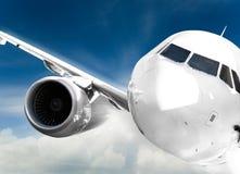 Avion dans le ciel Photos stock