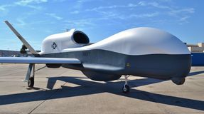 Avion de bourdon/espion de MQ-4C Triton Photographie stock