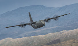Avion de charge de Herculues C130 Photos stock