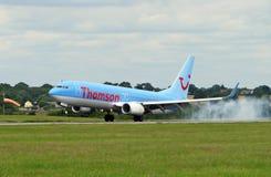 Avion de compagnies aériennes de Thomson Photo stock