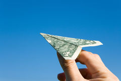 Avion de dollar US Images stock