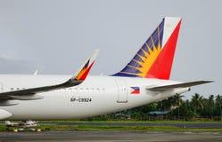 Avion de lignes aériennes de Philippines à l'aéroport dans Kalibo, Philippines Photographie stock libre de droits