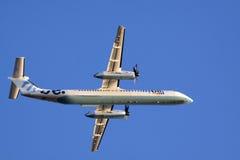 Avion de moteur de puissance de jumeau de tiret de bombardier Images libres de droits