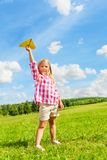 Avion de papier de fille Photographie stock libre de droits
