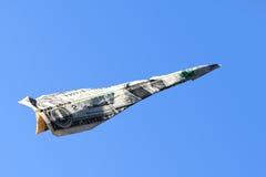 Avion de papier du dollar Images libres de droits