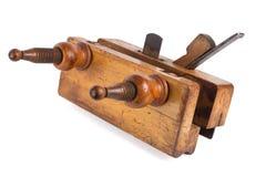 Avion en bois de vieil outil de charpentier sur un blanc Photo stock