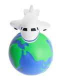 Avion et globe de jouet Image libre de droits