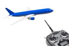 Avion et radio de RC à télécommande Photographie stock libre de droits
