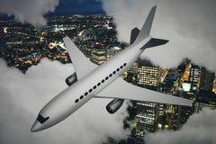 Avion et ville de nuit Photo libre de droits