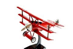 Avion rouge de jouet Photographie stock