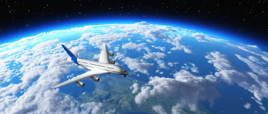Avion volant au-dessus de la planète Photographie stock libre de droits