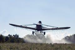 Aviones de la polvoreda de la cosecha Foto de archivo libre de regalías