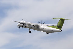 Aviones de la rociada 8 de AirBaltic de Havilland Canadá DHC-8-402Q Imagenes de archivo