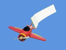 Aviones que tiran de la bandera del anuncio Imágenes de archivo libres de regalías