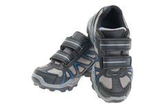 Avions-écoles de garçons ou chaussures de course photos stock