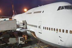 Avions chargés à la porte par Photo libre de droits