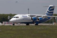 Avions d'Avro RJ85 d'espace britannique d'Ellinair se préparant au décollage de la piste Photographie stock libre de droits