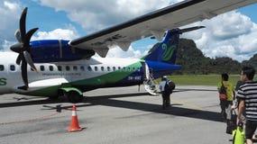 Avions de Maswings à l'aéroport de Mulu Images stock