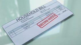 Aviso del segundo de la cuenta del hogar, mano que sella el sello en el documento, pago, tarifa almacen de video