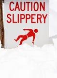 Aviso escorregadiço da neve Foto de Stock Royalty Free