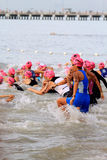 Aviva Ironman Triathlon. Female triathletes entering towards the sea for the first leg of the competition Stock Photos