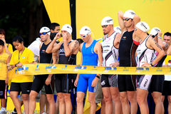 Aviva Ironman Triathlon. Male competitors gearing up behind the starting point for the flag off Stock Photography