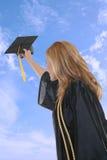 avläggande av examenkvinna Arkivbild