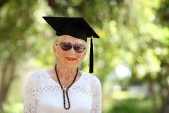 avläggande av examenpensionär Arkivfoton