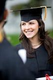 avläggande av examenståendekvinna Arkivfoto