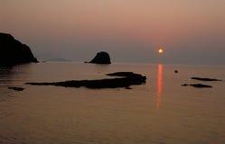 avlägsen solnedgång Arkivfoto