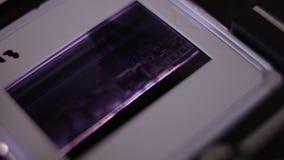 Avläsande 35mm glidbanor lager videofilmer