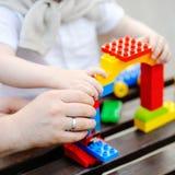 Avla med litet barnsonen som spelar med plast- kvarter Royaltyfria Foton