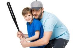 Avla undervisa hans son hur man play baseball Arkivbild