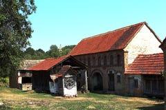 Avlija. Backyard and barn of the abandoned house Stock Image