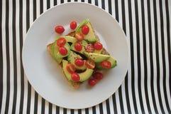 Avo и томаты на здравице Стоковые Фото