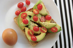 Avo and tomatoes on toast Stock Photo