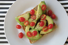 Avo and tomatoes on toast Royalty Free Stock Images
