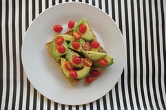 Avo and tomatoes on toast Stock Photos
