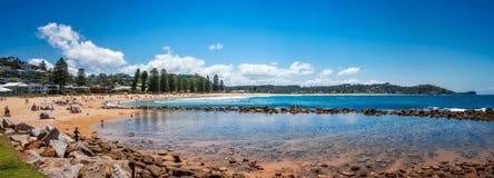 Avoca Beach Panorama, Australia. Avoca Beach, Central Coast, Australia - November 12, 2017: People enjoying a beautiful sunny day at Avoca Beach on the Central Royalty Free Stock Image