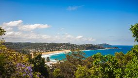 Avoca Beach - Australia. Avoca Beach -  View from above in between trees on a beautiful sunny day on the Central Coast, New South Wales, Australia Stock Photography
