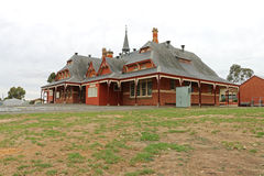 The Avoca primary school (1878) is a red brick building with a slate roof and verandah that encircles the building stock photography
