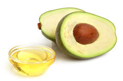 Avocado. And vegetable oil on white background Royalty Free Stock Image